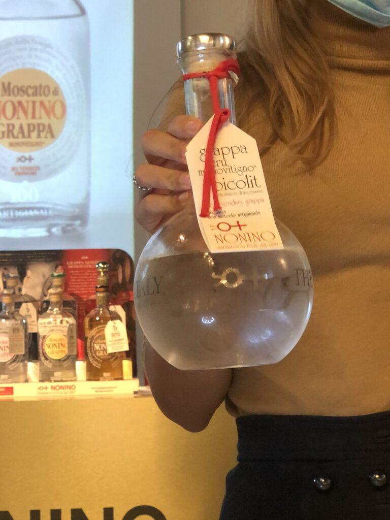 """Francesca Nonino holding the """"perfume bottle"""" grappa monovitigno Picolit"""