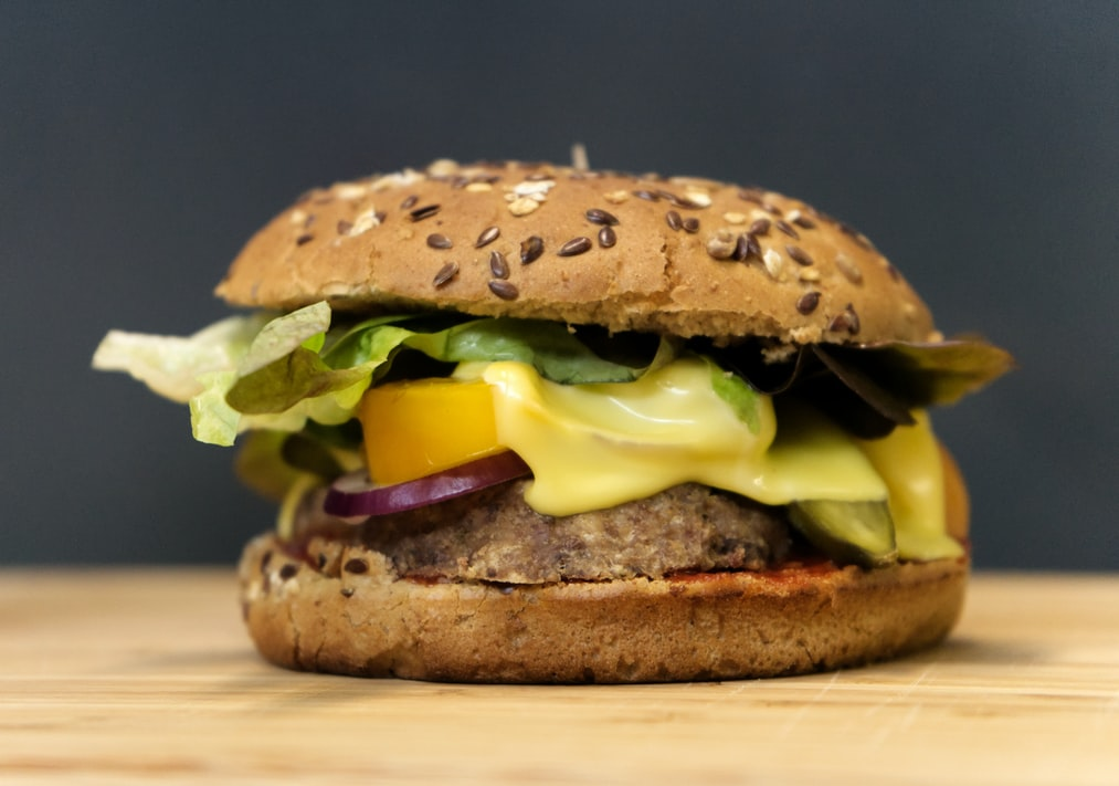 Vegetarian-burger-with-cheese-tomato-onion-and-salad